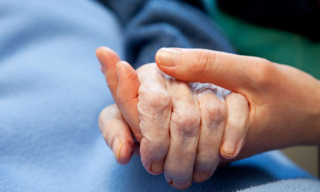 dying person hand in hand