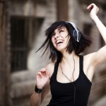 girl listening music while dancing, Frisson