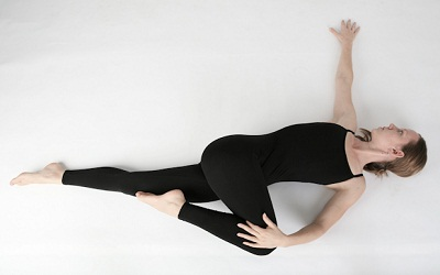 Chakrasana (Lying down body twist) to increase height